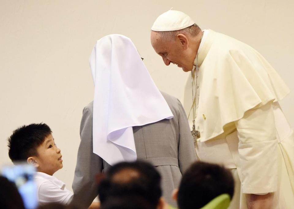 Pope Francis visited with a boy at the House of Hope center in Kkottongae, South Korea, on Saturday.