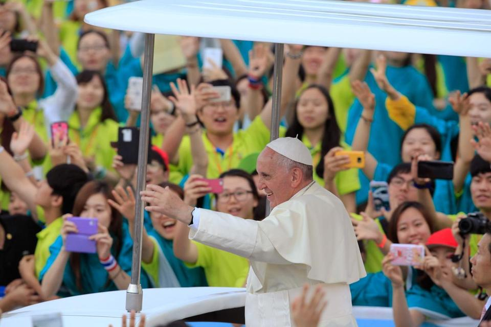 Pope Francis waved to the crowd upon his arrival for Asian Youth Day earlier this month in South Korea.