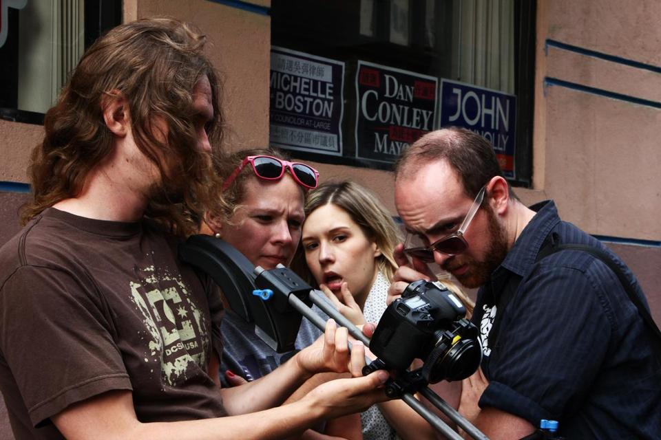 "Web series ""K&A"" production staff — (from left) Ben Heald,  Katie Shannon, Audrey Claire, and Mike Madden  — watching a playback of a scene they shot in Boston's Chinatown."