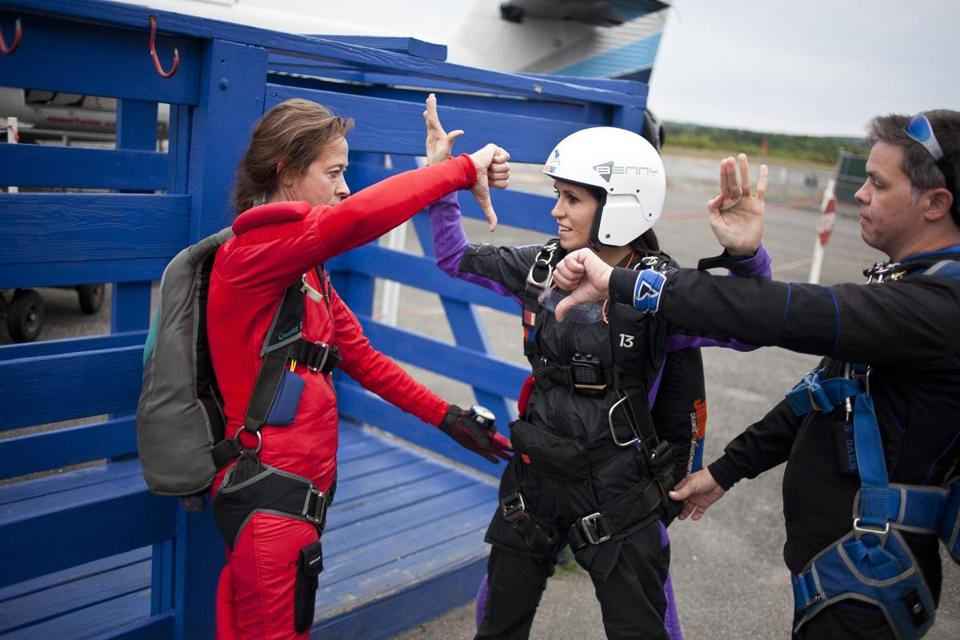 Skydivers practiced their technique in preparation for their next jump.