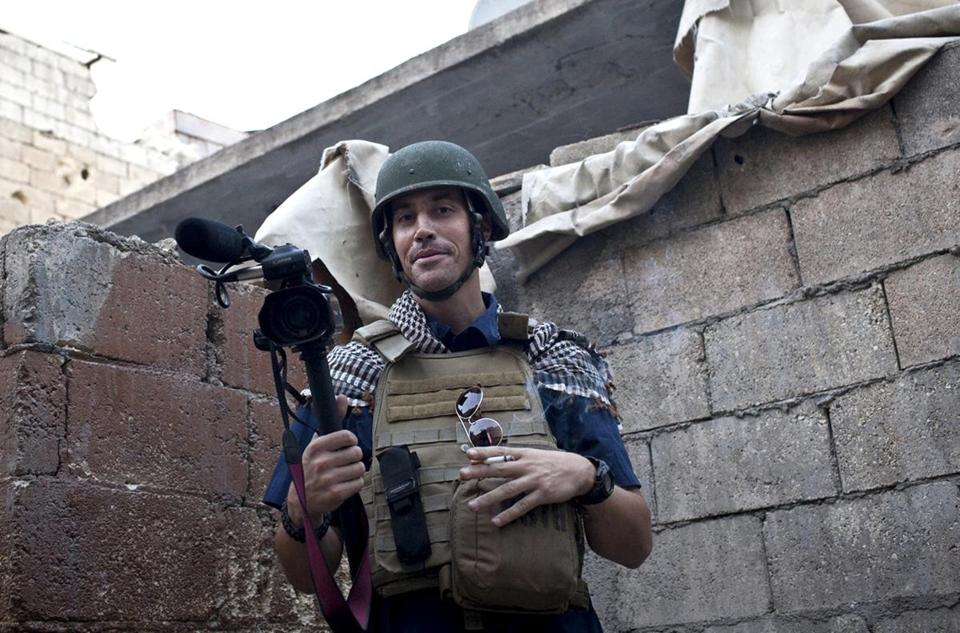 James Foley pauses while covering the civil war in Aleppo, Syria, in November 2012.