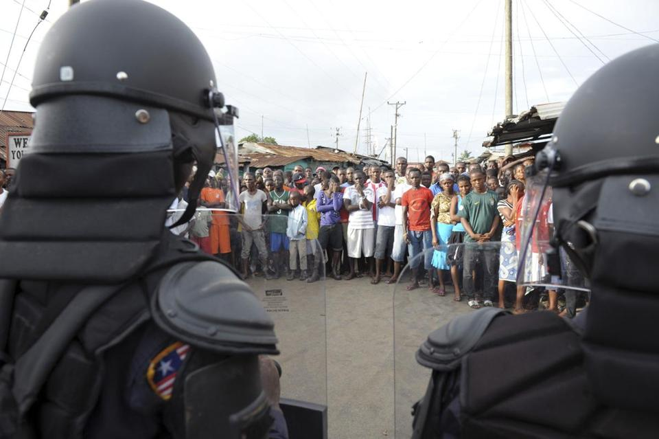 Liberian security forces fired live rounds and tear gas on Wednesday to disperse a crowd trying to break a quarantine.