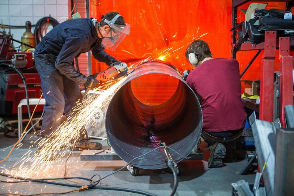 Employees  at Keystone Tower Systems worked on a piece of a wind turbine at Greentown Labs in Somerville.