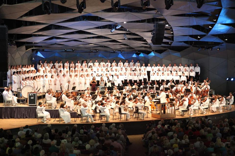 Charles Dutoit leading the Boston Symphony Orchestra, the Tanglewood Festival Chorus, and vocal soloists in the traditional Tanglewood season-ending performance of Beethoven's Ninth Symphony on Sunday.