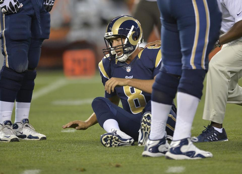 Rams quarterback Sam Bradford sits on the field after he was injured in the first quarter Saturday night against the Browns.David Richard/Associated Press