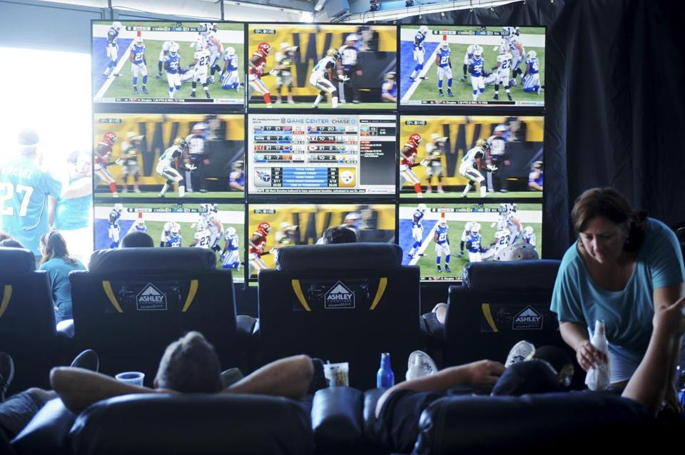 Fans look at multiple screens showing games around the NFL league inside the Jacksonville Jaguars' fantasy football lounge at EverBank Field. Yahoo! will stream the Jaguars' game against the Bills on Oct. 25.