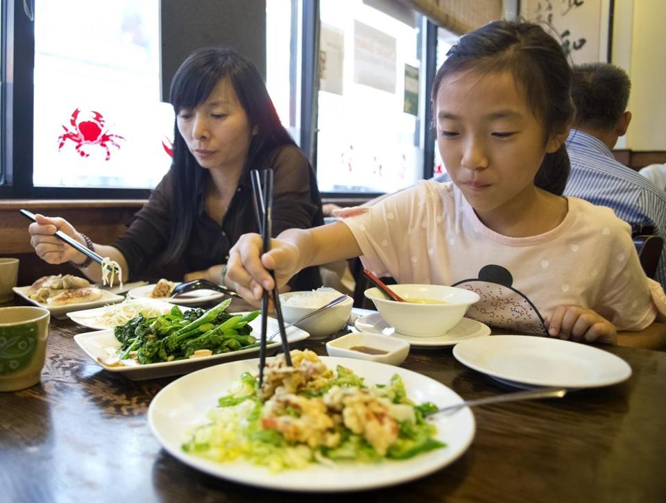 Chen Xin Zi Jie and her mother, Zhang Xiong Wen, dine at Dumpling Cafe. Steak tacos and more are available at Taqueria El Amigo. Below right: The vegetarian falafel from To Beirut.
