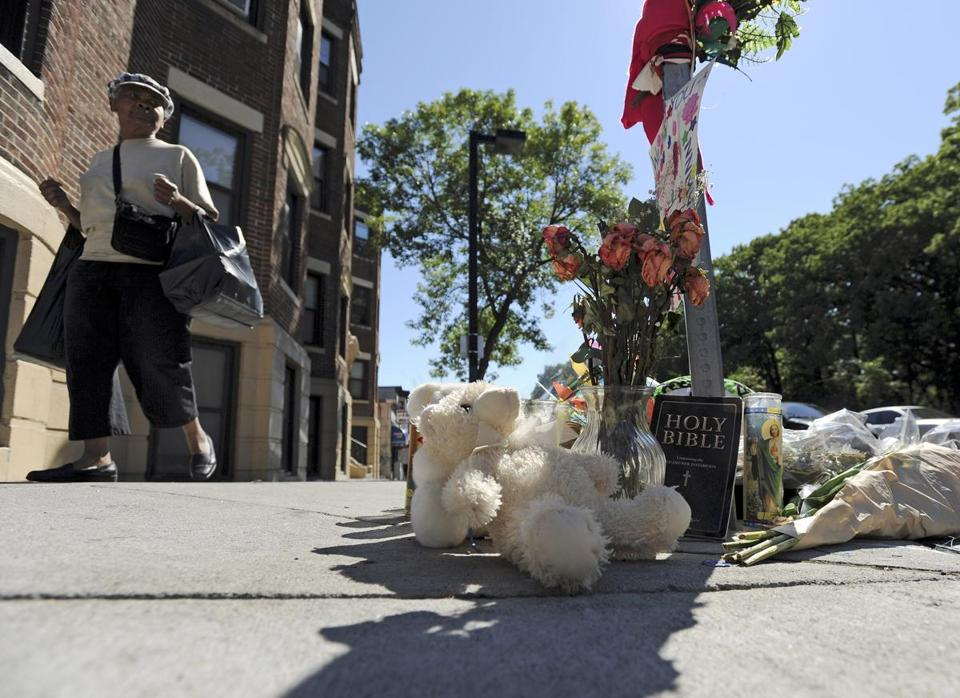 A makeshift memorial was set up in Dorchester at Blue Hill Avenue and Charlotte Street where Dawnn Jaffier was shot.