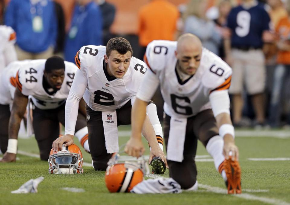 Browns first-round pick Johnny Manziel, center, will start the season as a backup to Brian Hoyer, right.
