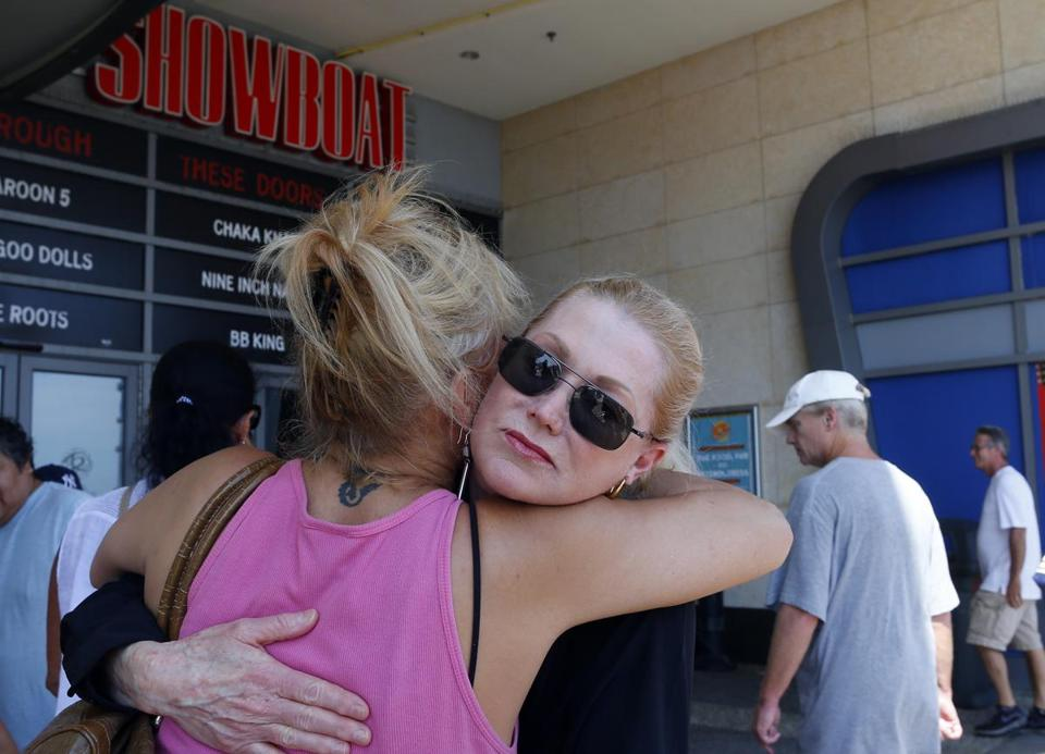 Workers Wendy Fitzpatrick (left) and Ruth Ann Joyce hugged hours before Atlantic City's Showboat casino closed Sunday.