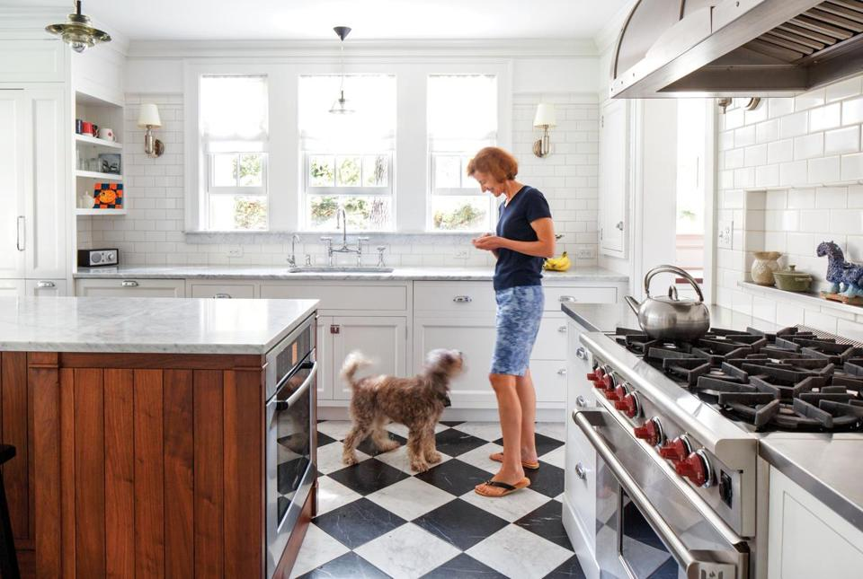 Homeowner Anne Fantozzi chose a black and white marble floor for its ability to hide the wear and tear of kids — and pets.