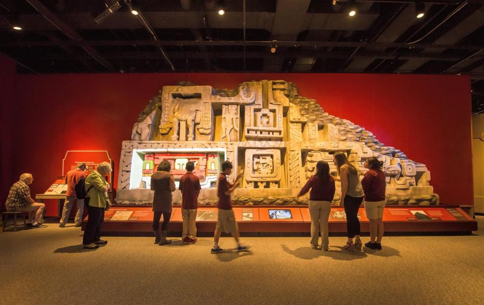 "Visitors to the Museum of Science view a part of the ""Maya: Hidden Worlds Revealed"" exhibit."