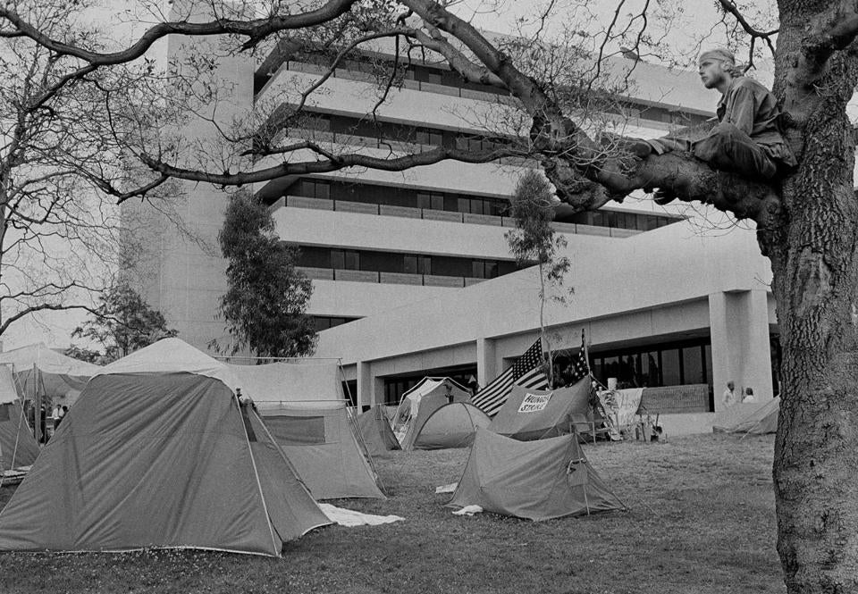 At Wadsworth VA Hospital in West Los Angeles in 1981, Vietnam veterans camped out after the suicide of a disabled Marine who had rammed the front door with a Jeep and sprayed gunfire to protest lack of treatment.