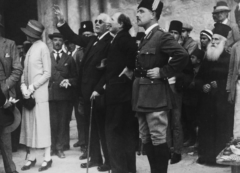 British politician Lord Arthur Balfour (1848 - 1930) points out a feature of the Church of the Holy Sepulchre to Governor Sir Ronald Storrs during a visit to Jerusalem, 9th April 1925. The city's Arab residents were on strike as a protest against the Balfour Declaration supporting plans for a Jewish homeland in Palestine. (Photo by Topical Press Agency/Hulton Archive/Getty Images)