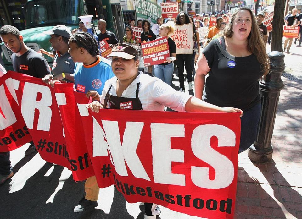 Fast food workers and their supporters marched down Washington Street in Downtown Crossing on Thursday.