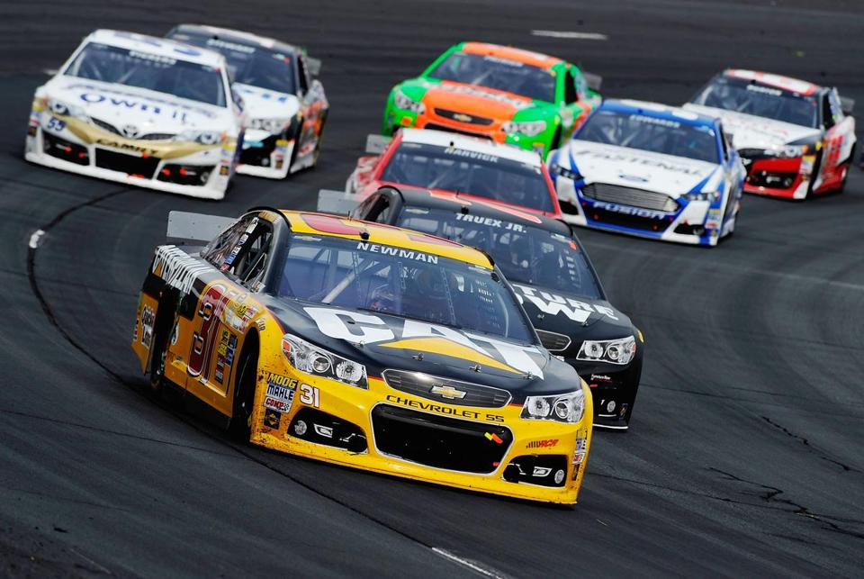 LOUDON, NH - JULY 13: Ryan Newman, driver of the #31 Caterpillar Chevrolet, leads a pack of cars during the NASCAR Sprint Cup Series Camping World RV Sales 301 at New Hampshire Motor Speedway on July 13, 2014 in Loudon, New Hampshire. (Photo by Jared C. Tilton/Getty Images)