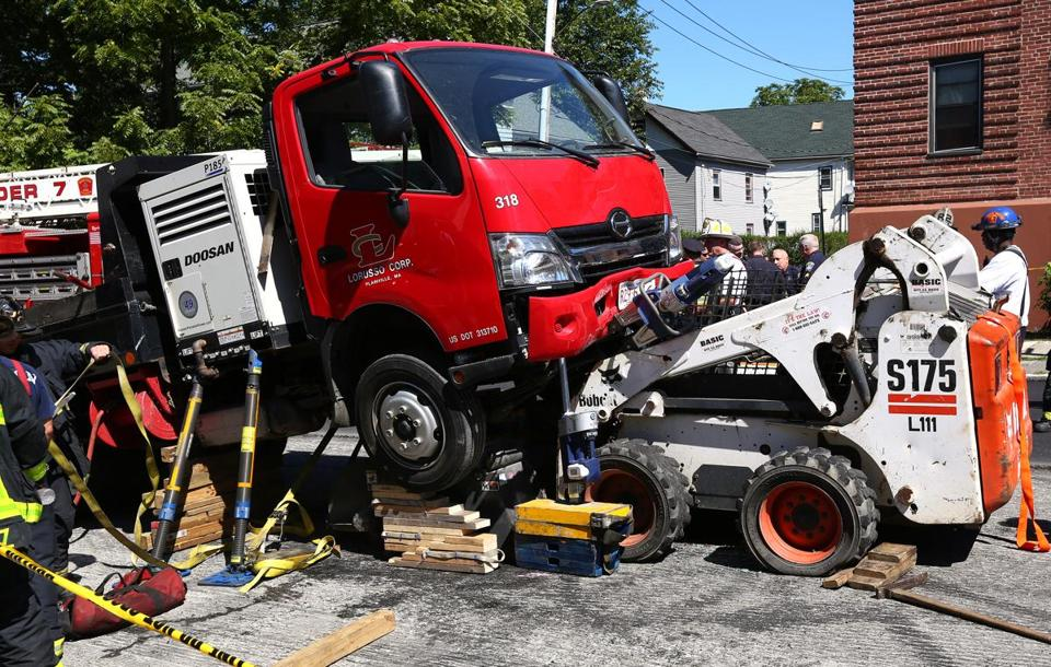 Perfect Rescue Crews Had To Use Hydraulic Lifts To Free The Victim.
