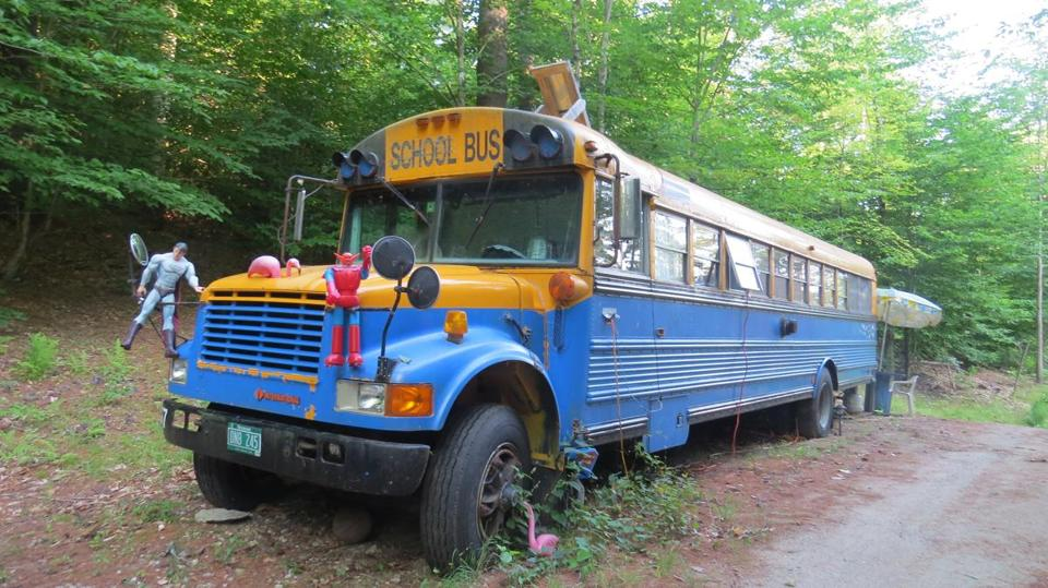 Making a cross-country road trip memorable, the author reserved stays in a school bus (where the family slept) in Thorton, N.H.