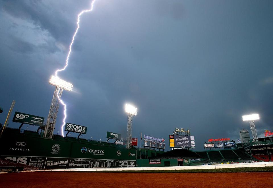 A lightning bolt illuminates the sky near Fenway Park in 2014. You are many times more likely to be hit by lightning —  or killed by a shark or hit by an asteroid — than win the Powerball jackpot.