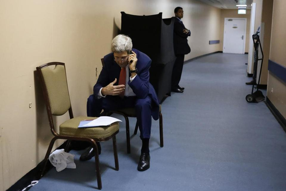 US Secretary of State John Kerry sat in a service hallway of a hotel in Cairo, Egypt, on July 25, as he spoke with Qatar's Foreign Minister Khaled al-Attiyah on the phone. The two discussed terms of a cease-fire in fighting in Gaza.