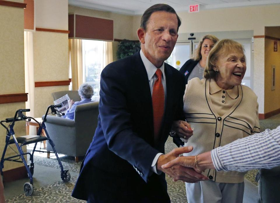 Steve Grossman walked with resident Shirley Spero during a campaign visit to Brooksby Village senior living in Peabody on Monday.