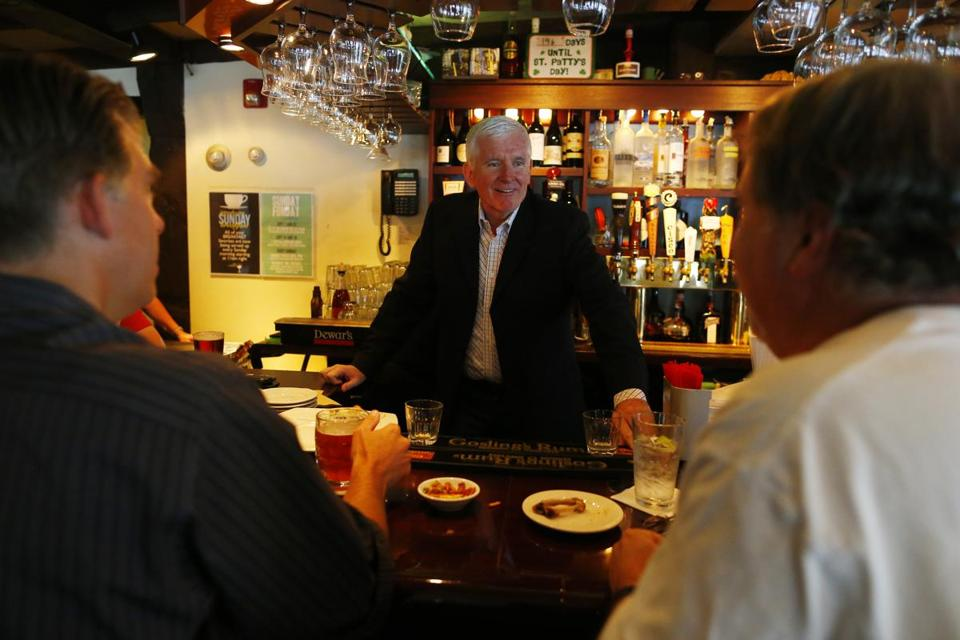 Paul Barclay chats with customers at the bar in The Landing.