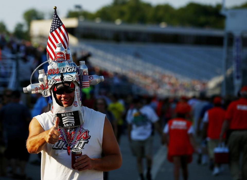 LOUDON, NH - JULY 12: A fan walks through the grandstands during the NASCAR Nationwide Series Sta-Green 200 at New Hampshire Motor Speedway on July 12, 2014 in Loudon, New Hampshire. (Photo by Jared Wickerham/Getty Images)