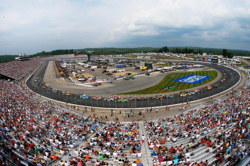 LOUDON, NH - JULY 13: A view of cars racing during the NASCAR Sprint Cup Series Camping World RV Sales 301 at New Hampshire Motor Speedway on July 13, 2014 in Loudon, New Hampshire. (Photo by Chris Trotman/Getty Images)
