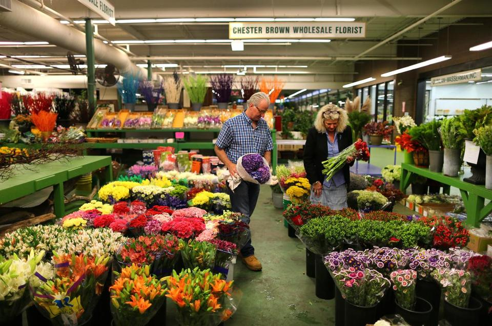 Boston- 09/11/14- David Brown and his wife Ann own Chester Brown Wholesale Florists inside the Boston Flower Exchange. Boston Globe staff photo by John Tlumac ki(metro)