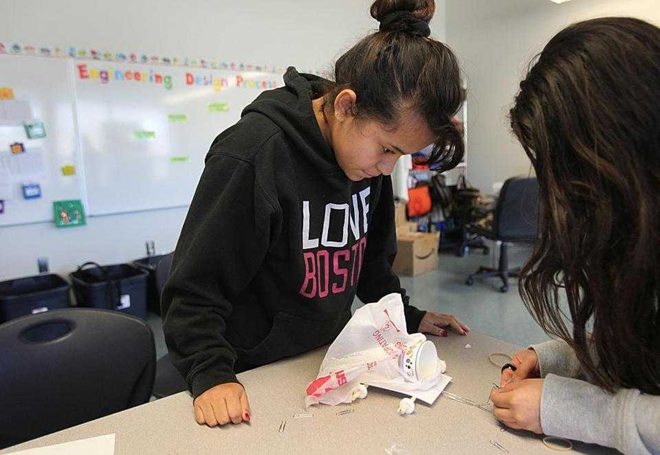 Boston, MA. 09/12/14, Helen Meza and Cheyenne Reyes, cq, make a vehicle out of paper clips, life savers, paper and plastic bags. They are 8th graders in an engineering and robotics class at the Elliot Innovation Charter school. For Education Magazine. Suzanne Kreiter/Globe staff (The Boston Globe.