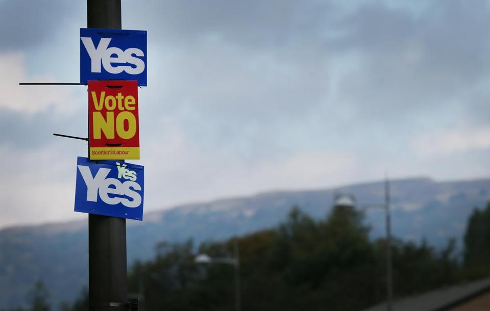 Yes and No campaign placards adorned a lamp post in sight of the Campsie Fells in Glasgow on Tuesday
