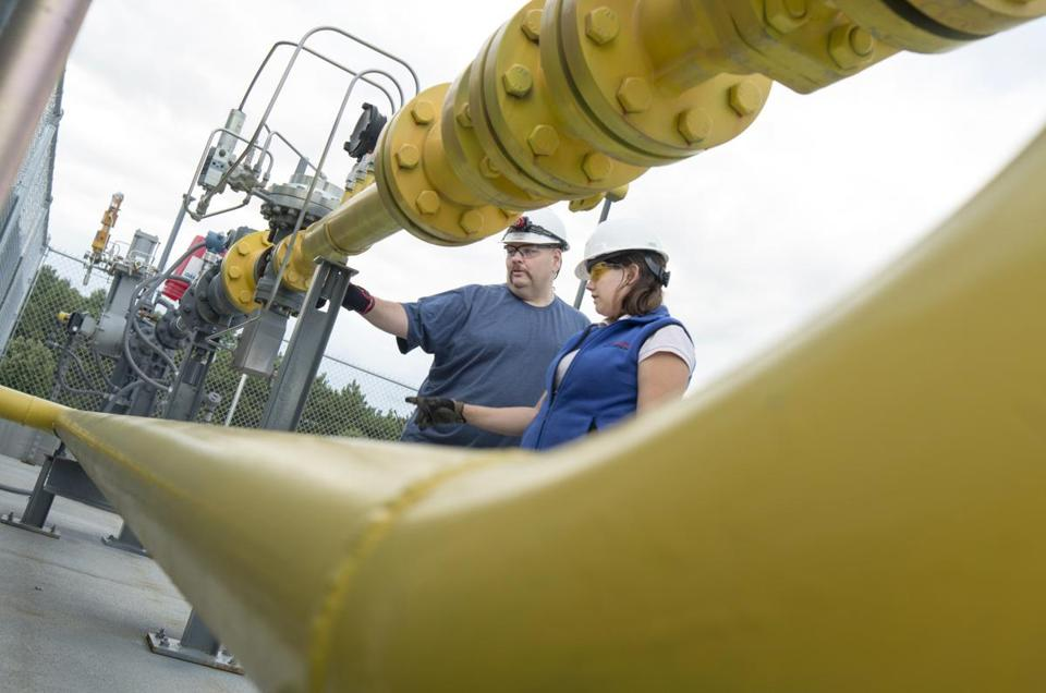NG Advantage employees monitor a gas-compressor system at its plant in Milton, Vt.