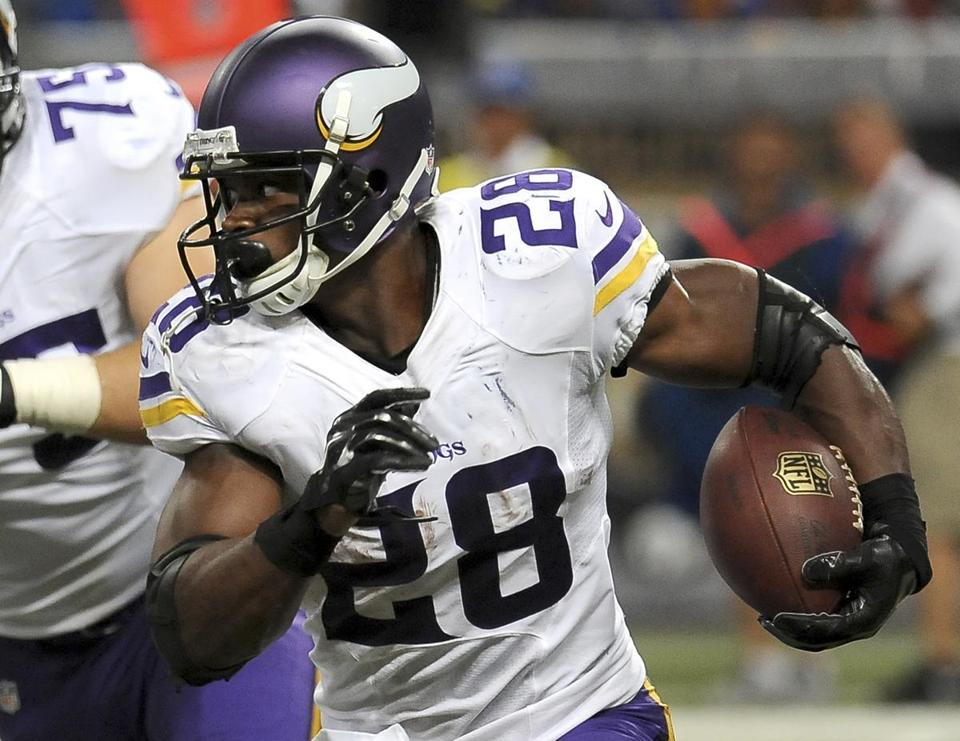 533b625b0 Adrian Peterson remains away from the Minnesota Vikings while he awaits a  trial date for reckless