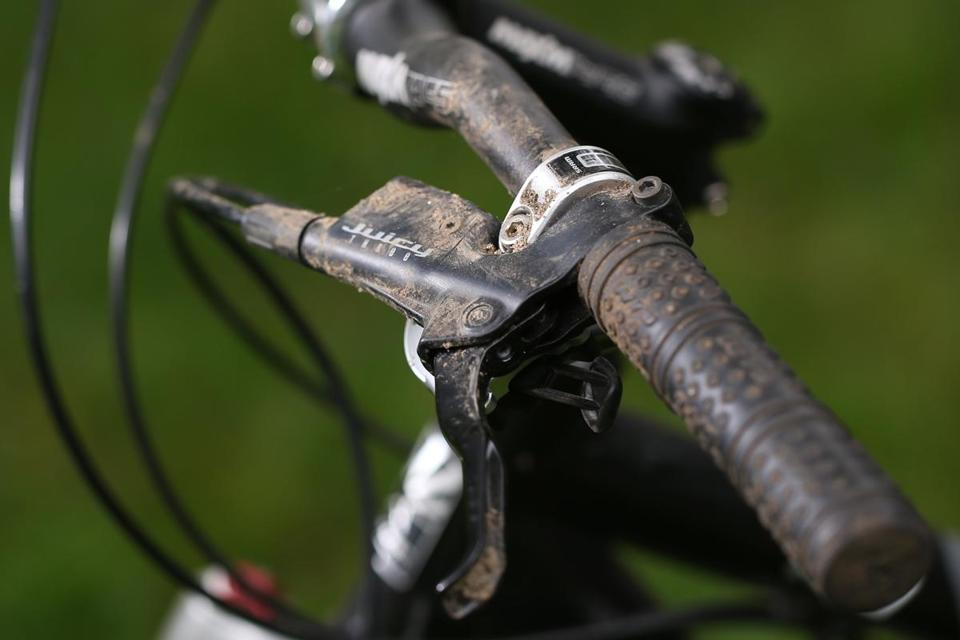 The handlebars on Randy Pritzker's bicycle are still covered in dirt from the day of his accident.