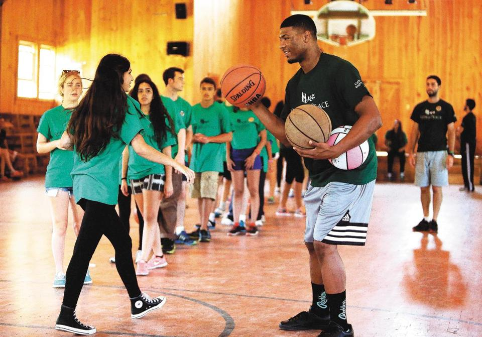 Marcus Smart was one of several NBA players who volunteered their time for the Seeds of Peace camp in Otisfield, Maine, last month.