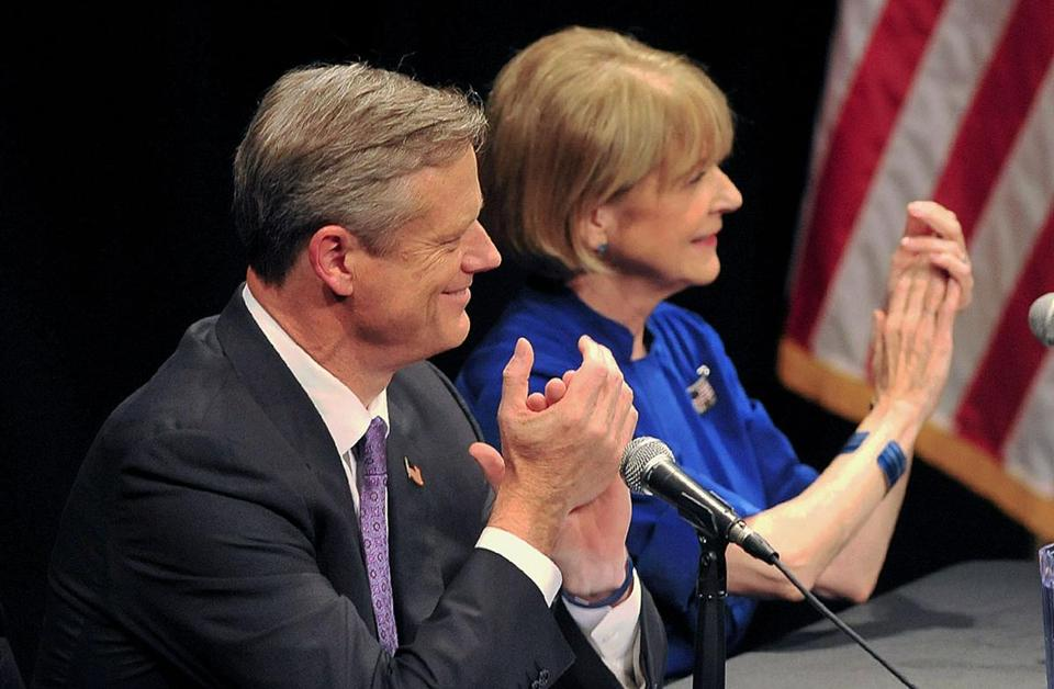 Republican Charlie Baker and Democrat Martha Coakley applauded at the start of a debate in Springfield, Mass. on Monday night. Sept. 29, 2014.