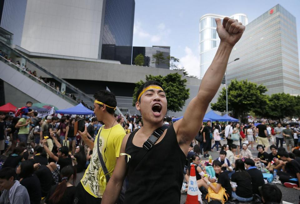 A prodemocracy activist shouted slogans on a street near government headquarters in Hong Kong.