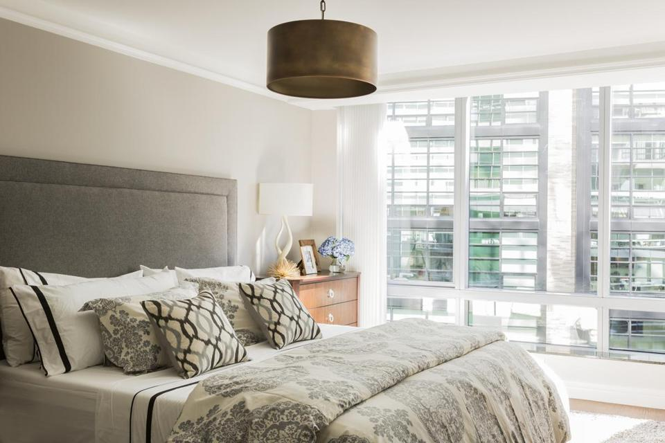 Large windows fill the bedroom with sunlight.