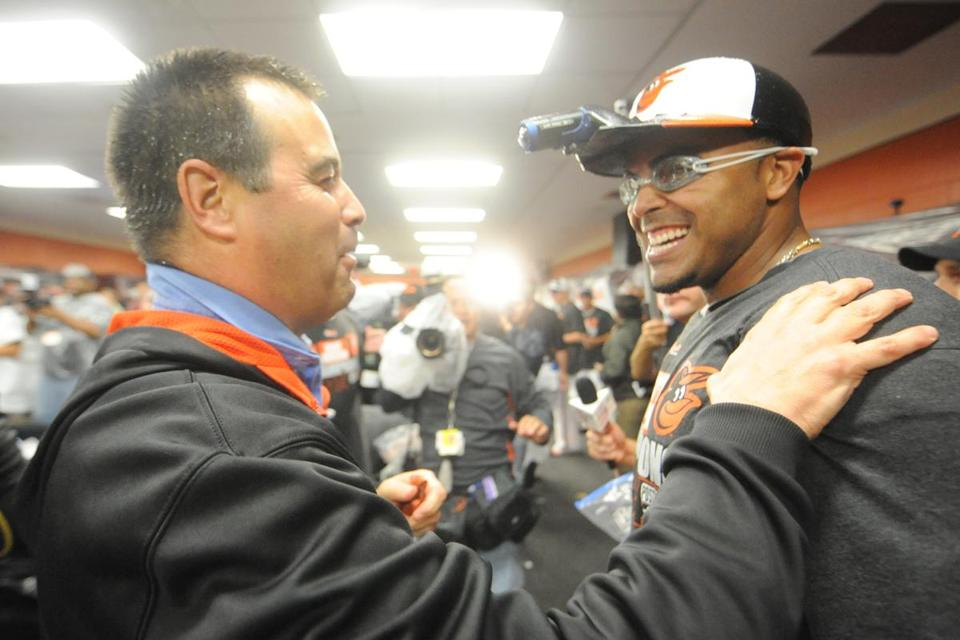 Dan Duquette and Nelson Cruz celebrate the AL East title.