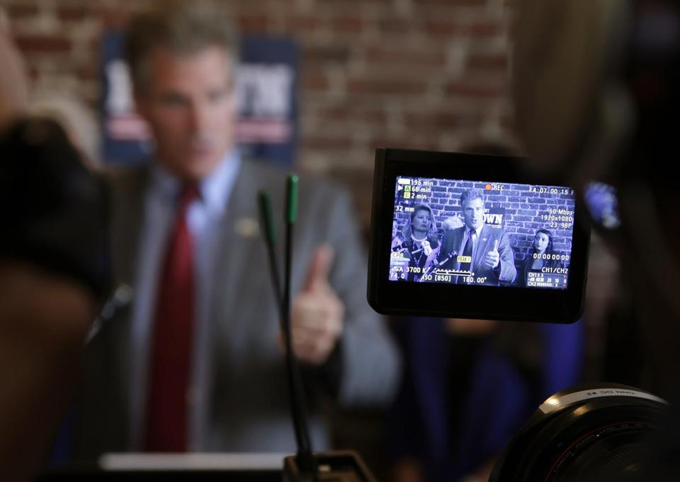 New Hampshire Republican candidate Scott Brown is seen through the view finder of a camera during a campaign stop in Derry, N.H.