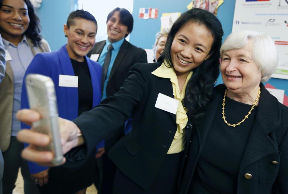 Thao Le-Nguyen poses for a selfie with Federal Reserve Chairman Janet Yellen, right, at the office of CONNECT, a coalition of local organizations that provides employment services in Chelsea, Mass., Thursday, Oct. 16, 2014. (AP Photo/Michael Dwyer)