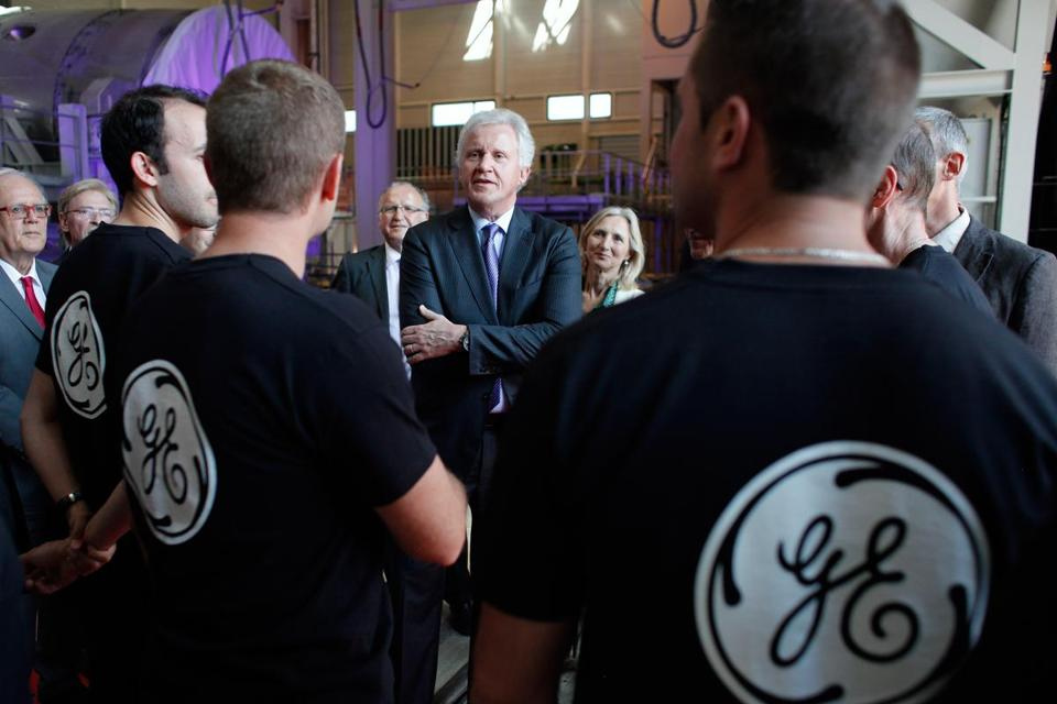 General Electric Co. CEO Jeffrey R. Immelt, center, spoke with workers as he visited a General Electric plant in Belfort, France in June 2014.