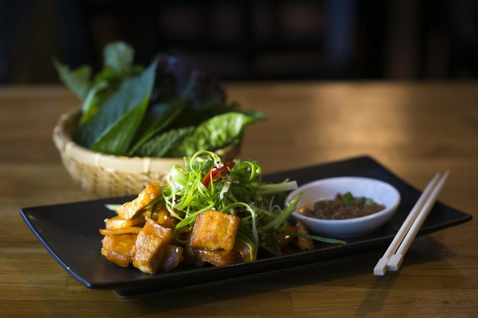 "October 16, 2014 Arlington, MA WooRi Korean Fusion Grill The ""Pork Belly"" - thick sliced pork belly with sesame oil on the side as well as a basket of lettuce and sesame leaves (Katherine Taylor for The Boston Globe)"