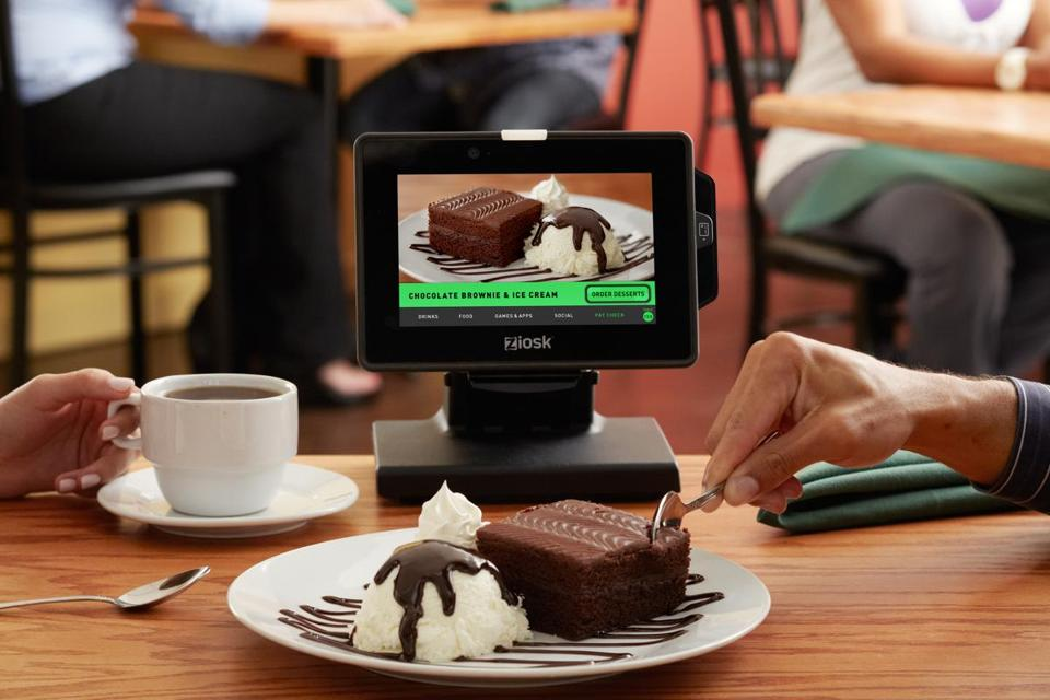 Technology is changing the service industry: Tableside tablets at restaurants, for instance, let diners order and pay for food without a waiter.