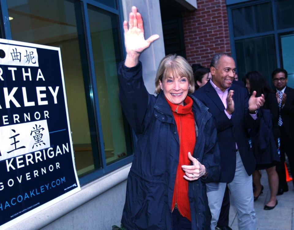 With Governor Deval Patrick at her side, Martha Coakley received the endorsement of leaders in the Asian American community on Sunday in Chinatown.
