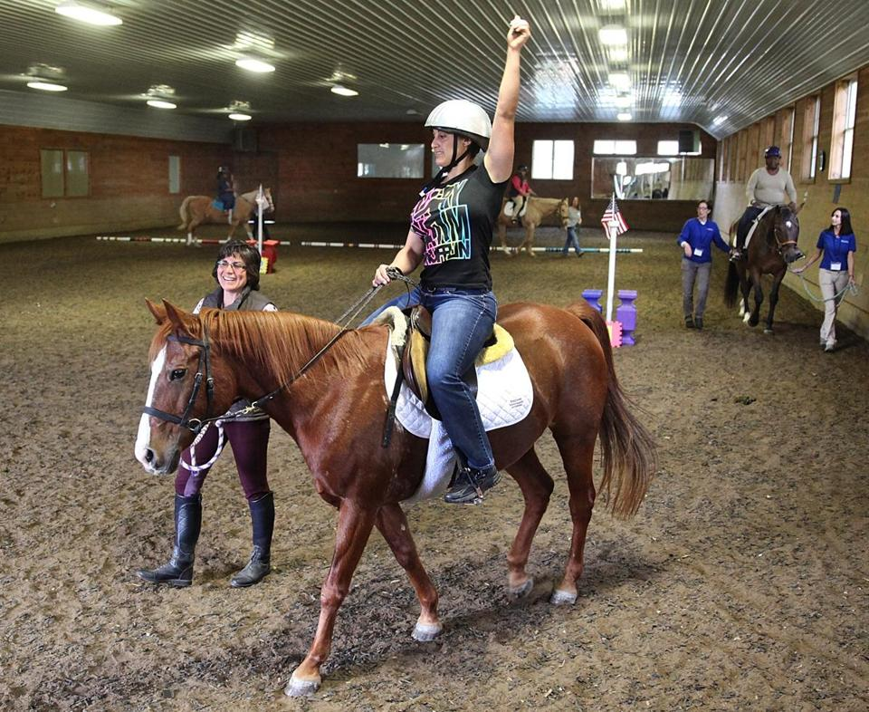 Veteran Elisa Long of Pennsylvania rode in the indoor arena on Dream.