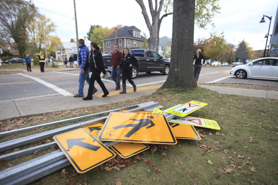 Street signs were torn down in Keene, N.H., in 2014. Police used tear gas to control crowds during disturbances near Keene State amid the pumpkin festival.