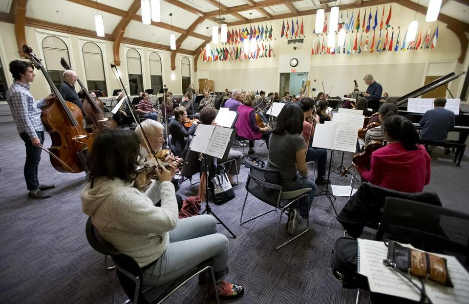 The New England Philharmonic rehearsing recently at Simmons College.
