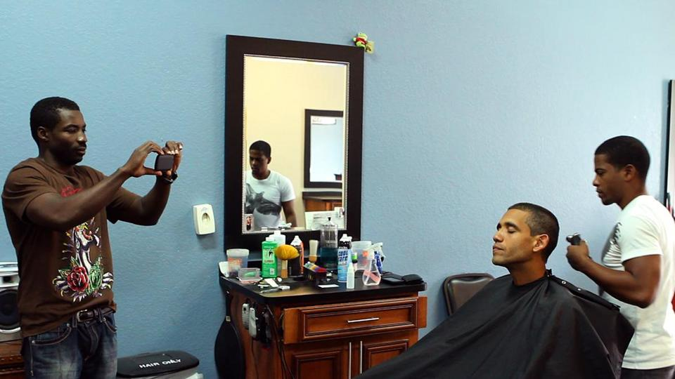 Louis Ortiz is photographed as he gets a haircut in a scene from the Showtime documentary.