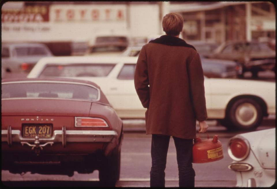 Some Motorists Ran Out of Gas Such as This Man in Portland and Had to Stand in Line with a Gas Can During the Fuel Crisis in the Pacific Northwest 12/1973. Photographer: David Falconer. Part of DOCUMERICA (http://research.archives.gov/description/542493). Original link: https://www.flickr.com/photos/usnationalarchives/4272498928/ Credit: The US National Archives